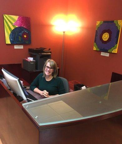 Sarah at front desk